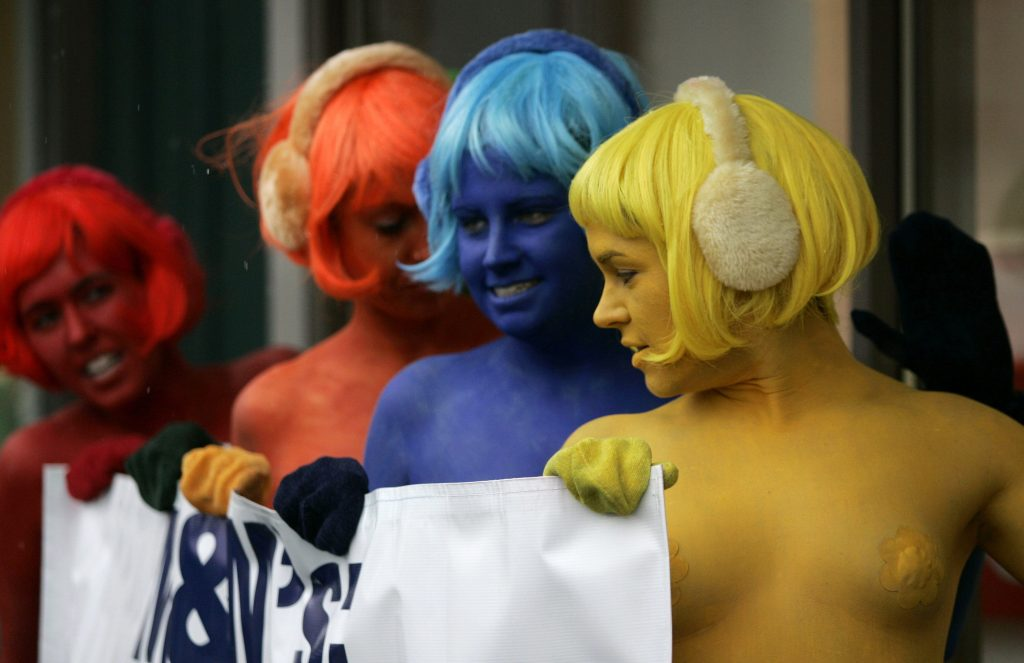 PETA (People for the Ethical Treatment of Animals) members, wearing M&M-colored body paint, protest against Mars' cruel animal tests, in Washington January 17, 2008. PETA members asked the public to boycott Mars' products because of their conducting and funding of animal experiments for its candy products. REUTERS/Molly Riley (UNITED STATES)